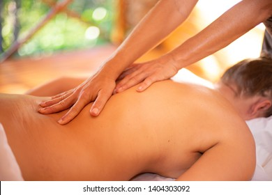 Close up of Woman receiving a spa Massage on a massage table by the hands of therapist. Panama, Panama, December 20 2018