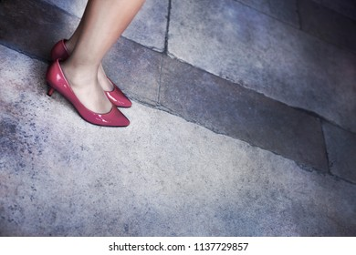 Close up of a woman and red shoes