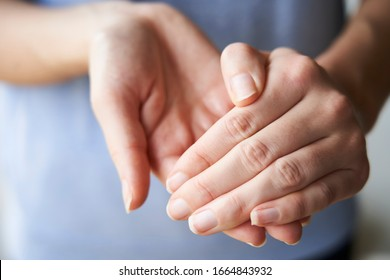 Close Up of a Woman rubbing her hands together with disinfectant