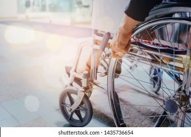 Close up of woman sitting and use wheel chair at hospital with copy space