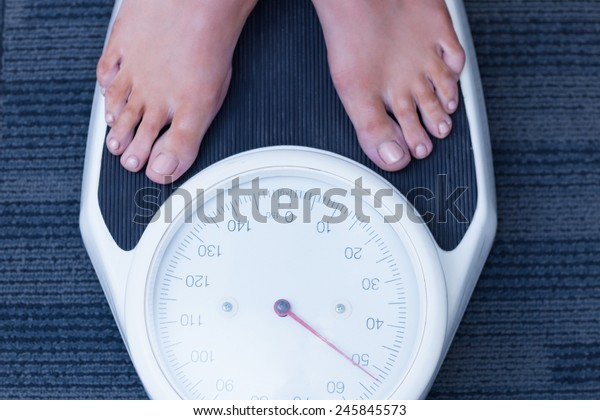 Close up of a woman standing on the scales in hospital
