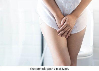 Close up woman stomachache with toilet in the morning, health care concept, selective focus