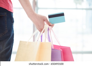 close up of woman take credit cards and shopping bag