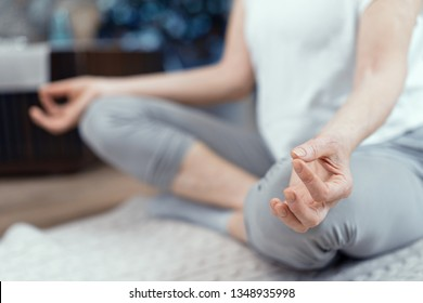 Close Up of Woman Taking Asana Position. A Woman Over 50 Years Old Doing Yoga at Home.