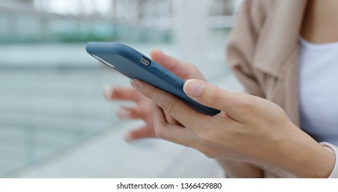 Close up of woman use of mobile phone at outdoor