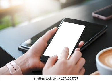 Close up of woman using cell phone,sending massages on the garden.having sunbath.Phone with black screen,texting,video calls,