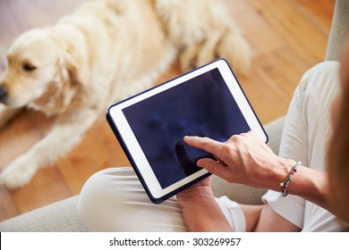 Close Up Of Woman Using Digital Tablet At Home