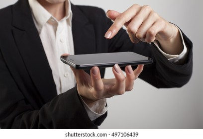 Close up of a woman using mobile smart phone