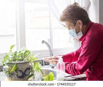 close up woman washing hands with soap from plastic bottle