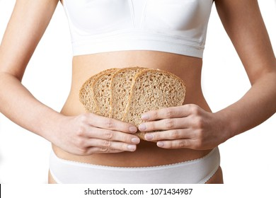 Close Up Of Woman Wearing Underwear Holding Slices Of Brown Bread