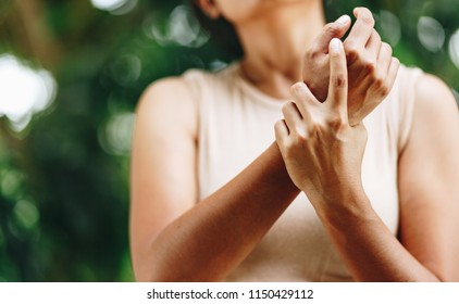Close up Woman wrist pain , office syndrome , health care concept
