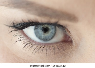 Close Up of Woman's Blue Eye with Heart Pupil