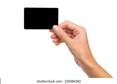Close up of woman's hand holding blank black card. Studio shot isolated on white.