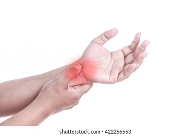 Close up woman's hand holding her wrist isolated on white background. Wrist pain concept.