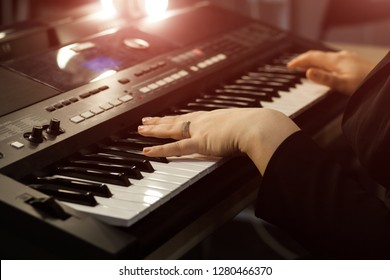 Close up of woman's hand playing the piano. Woman playing on electric piano. Female synthesizer player