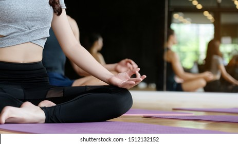Close up at a woman's hand yoga workout in the gym to change yourself to a healthy body and lose weight to have a beautiful shape. Have a relaxed mind. Suitable for people of all ages. copy space