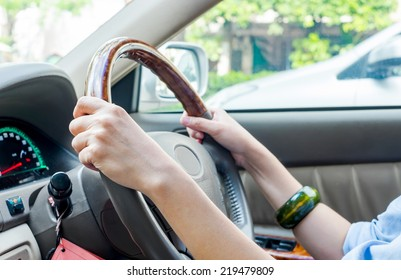 Close up of woman's hands drive a car,hands holding steering wheel