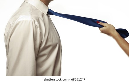 close up of womans hands pulling on a mans tie