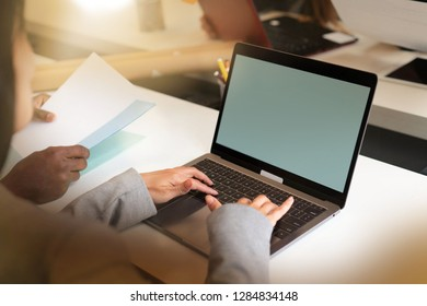 Close up of womans' hands typing on computer in offcie setting