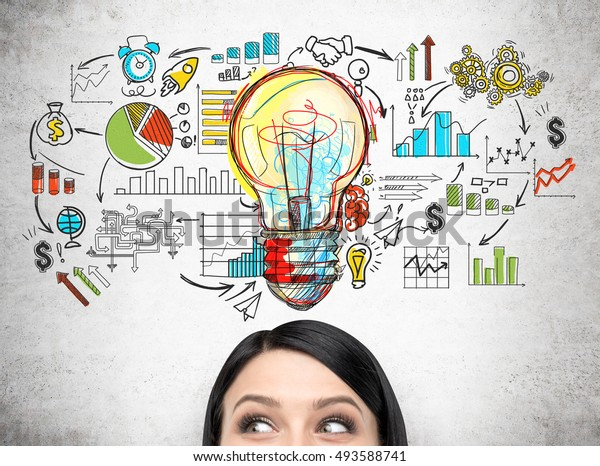 Close up of woman's head against concrete wall with giant light bulb and colorful startup sketch