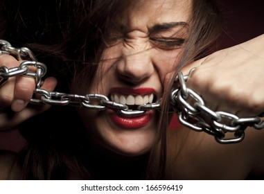 Close Up of Woman's Mouth with Chains
