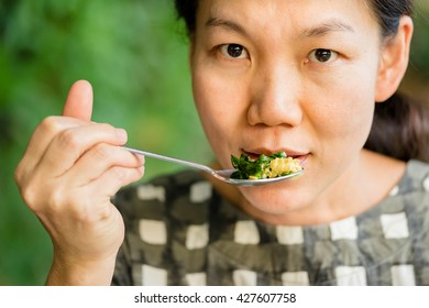 close up women eating in restaurant