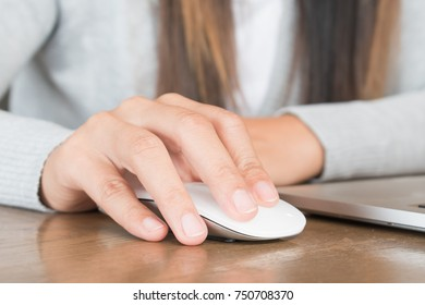 close up women hands useing laptop