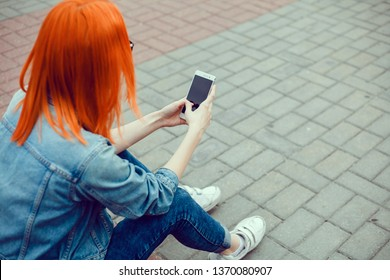 Close up of women's hands holding cell telephone with blank copy space scree for your advertising text message or promotional content, hipster girl watching video on mobile phone during coffee break