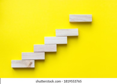Close up wood block stacking as step stair. Business concept growth success process. Concept of education, risk, development, and growth