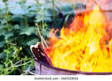 Close up of wood in a garden incinerator fire