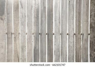 Close up wood panel texture of the fence with cavities isolated on white background