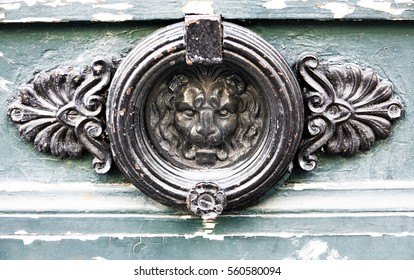Close up of a wood weathered door ornament on an old door in Paris, France