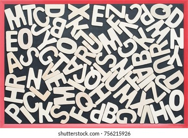 Close up wooden alphabet study english letters,ABC on the blackbroad as a background composition