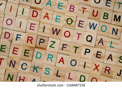 close up of a wooden alphabet tiles as a background. educational concept