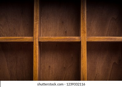 Close up of a wooden box with compartments