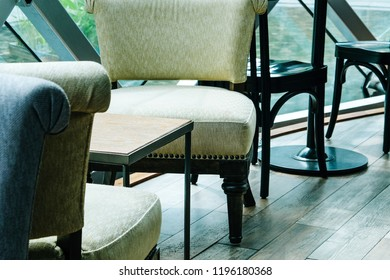 Close up wooden chairs and table in Cafe