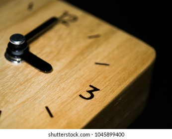 Close up wooden clock at three o'clock.