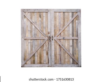 Close up wooden closed door of old barn isolated on white background.