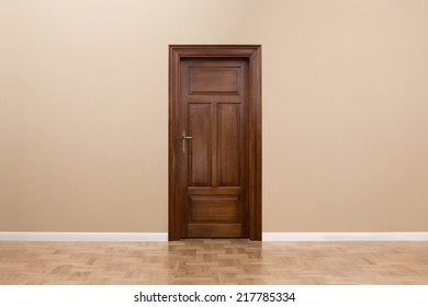 Close up of wooden door in the empty room with copy space