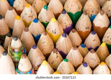 Close up of wooden handmade colored crayons