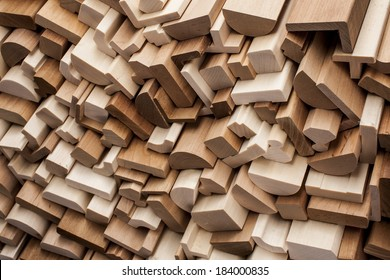 Close up wooden moldings in stack used for home decor