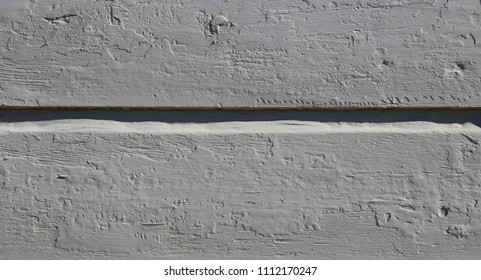 Close up of a wooden plank wall. Old, rustic texture with chipped paint. Interesting, beautiful horizontal lines and beautiful color. Photographed in the old town of Porvoo, Finland.