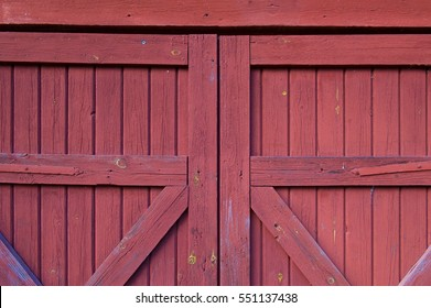 close up of a wooden red barn door background
