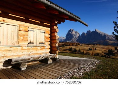 Close up of a wooden rural farmer's shed in Seiser Alm meadow in the Dolomites, North Italy, Sudtirol (Trentino / Alto Adige). Scenic autumn view of a big valley in the Alps Mountains