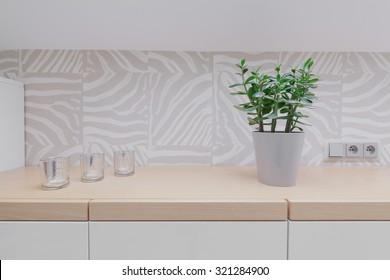 Close up of wooden worktop and modern design backsplash
