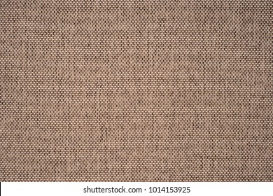 Close up of a woolen fabric of beige color. Abstract background, empty template. Top view.