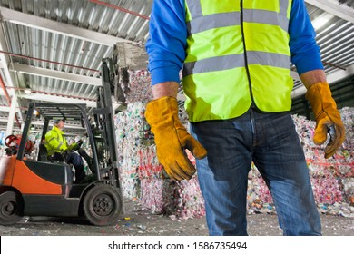 Close Up Of Worker With Forklift Moving Recycling Bales
