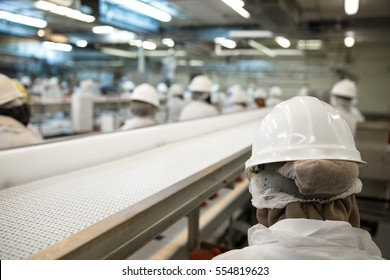 Close up of worker helmet in factory line job workplace shallow depth of field