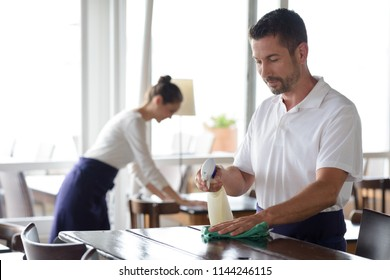 close up of worker in restaurant cleaning