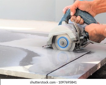 Close up worker use wet sawing machine for cutting marble stone